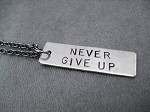 NEVER GIVE UP Necklace - 3/8 x 1 1/.4 inch Hand Hammered Nickel silver Pendant priced with Gunmetal chain
