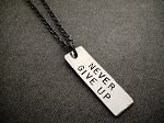 NEVER GIVE UP Necklace - 3/8 x 1 1/4 inch Hand Hammered Nickel silver Pendant priced with Gunmetal chain